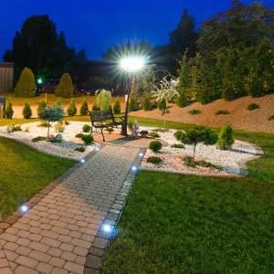 home garden illuminated with solar lights