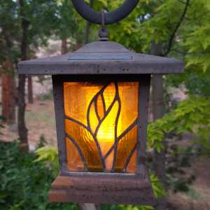 solar lantern hanging on a tree branch